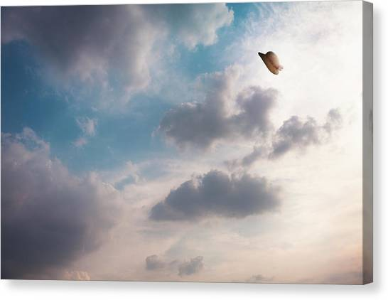 The Hat Flying In The Sky Canvas Print