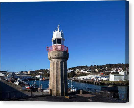 Waterford Canvas Print - The Lighthouse And Fishing Harbour by Panoramic Images