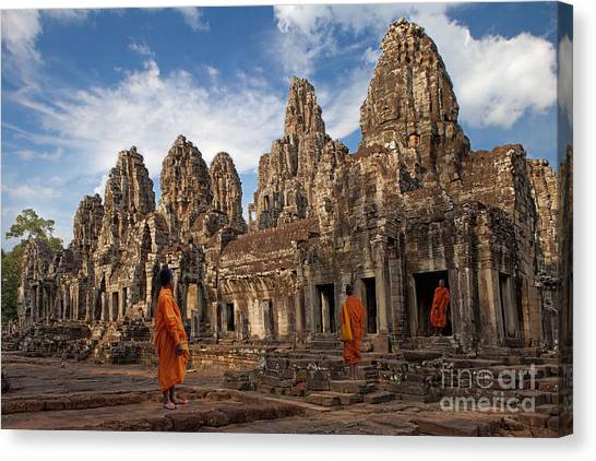 The Monks Of Bayon Canvas Print by Pete Reynolds