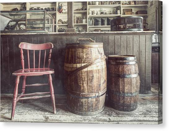 The Old General Store - Red Chair And Barrels In This 19th Century Store Canvas Print