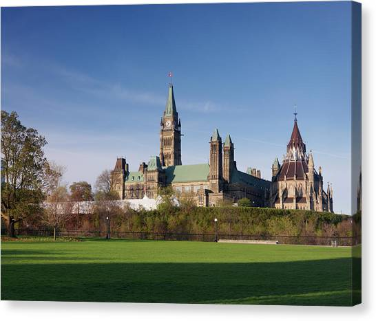 Parliament Hill Canvas Print - The Parliament Building In Ottawa by Oleksiy Maksymenko