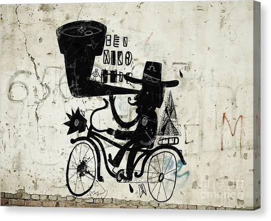 The Picture Shows A Man Who Rides A Canvas Print by Dmitriip