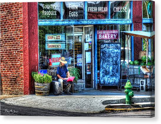 Figure On Bench - The Right Corner Canvas Print by Barry Jones