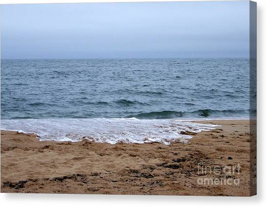 The Splash Over On A Sandy Beach Canvas Print
