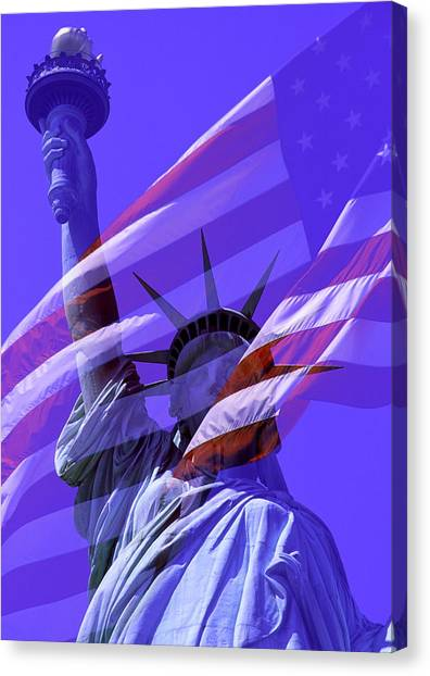The Statue Of Liberty Draped With The Flag Of The United States Canvas Print