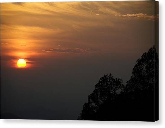 The Sun Behind The Trees Canvas Print