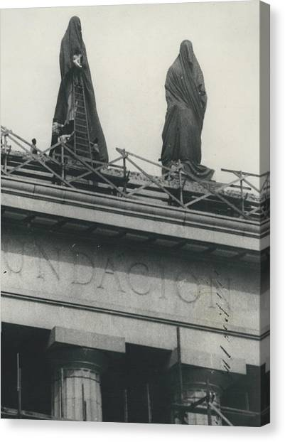 They Don't Like Them Any More; Peron Statues - Covered In Canvas Print by Retro Images Archive