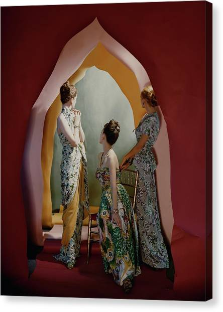 Three Models Wearing Patterned Dresses Canvas Print