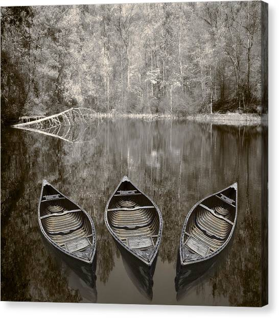 Three Old Canoes Canvas Print
