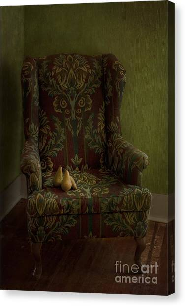 Wooden Floors Canvas Print - Three Pears Sitting In A Wing Chair by Priska Wettstein