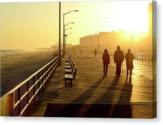 Casual Canvas Print - Three People Walking Down Boardwalk by Copyright Eric Reichbaum