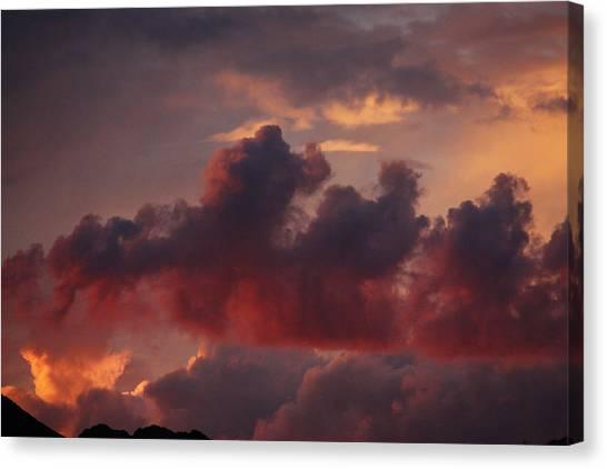 Three Sister Clouds Canvas Print