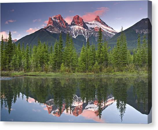Three Sisters Reflection Canvas Print by Richard Berry