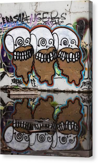 Urban Decay Canvas Print - Three Skulls Graffiti by Carol Leigh