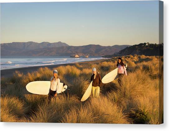 Surf Lifestyle Canvas Print - Three Women With Surfboards Walk by Ty Milford
