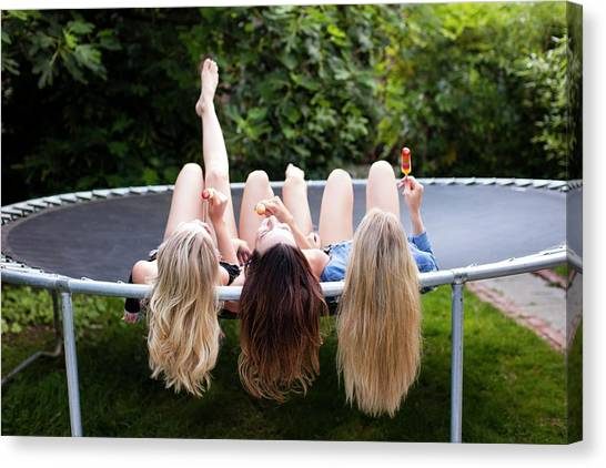 Trampoline Canvas Print - Three Young Women Lying On Trampoline by Science Photo Library