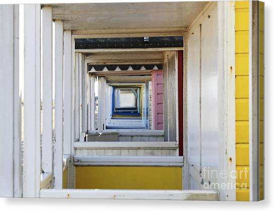 Through The Beach Huts Canvas Print