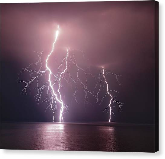 Lightning Canvas Print - Thunderbolt Over The Sea by Nini_filippini