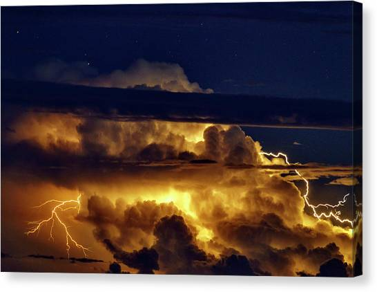 Thunderclouds Canvas Print - Thunderstorm From Haleakala by Babak Tafreshi