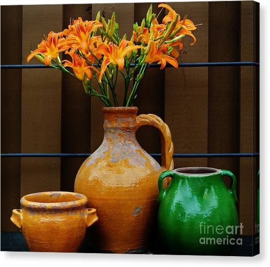 Tigerlilies And Pottery Canvas Print by Marsha Heiken