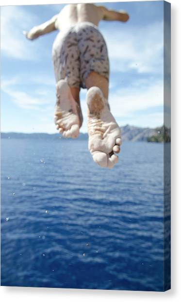 d31a50d203 Keri Canvas Print - Time To Cool Off A Young Man Jumps by Keri Oberly