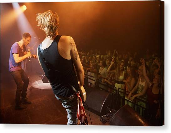 Time To Rock Out With A Solo... Canvas Print by PeopleImages
