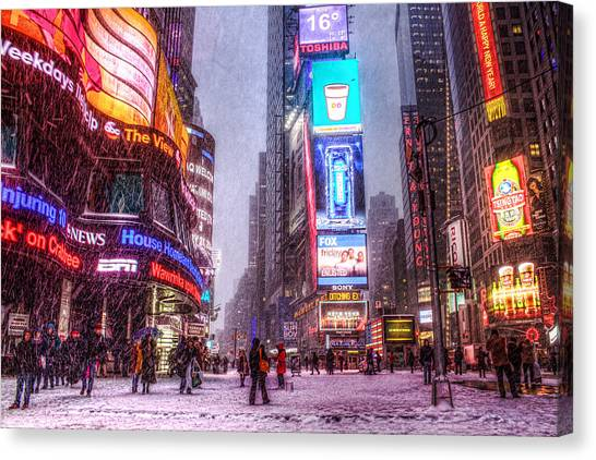 Times Square In The Snow Canvas Print by Zev Steinhardt