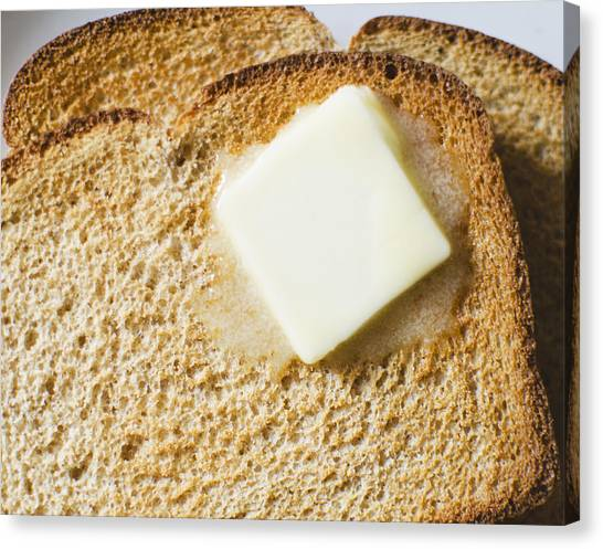 Toast With Meltin Butter Canvas Print by Jamie Grill