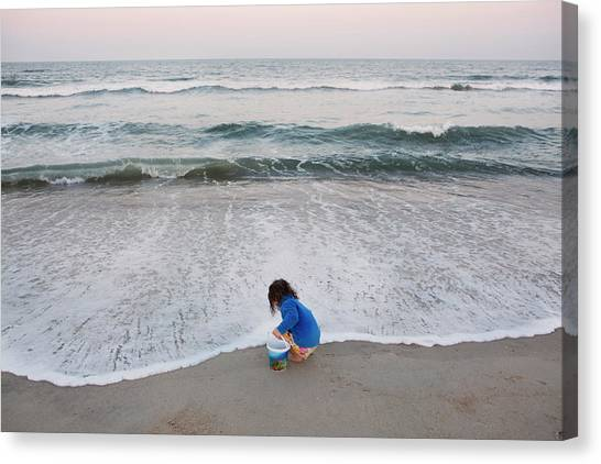 Toddler On The Edge Of The Ocean Canvas Print