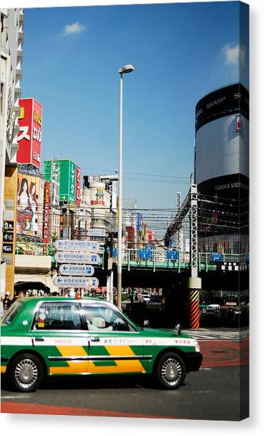 Tokyo Time Canvas Print by Ruby And Wolf