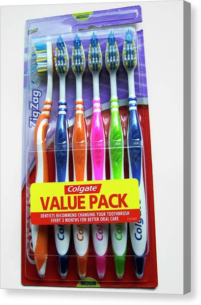 Toothbrush Canvas Print - Toothbrushes In Packaging by Ian Gowland/science Photo Library