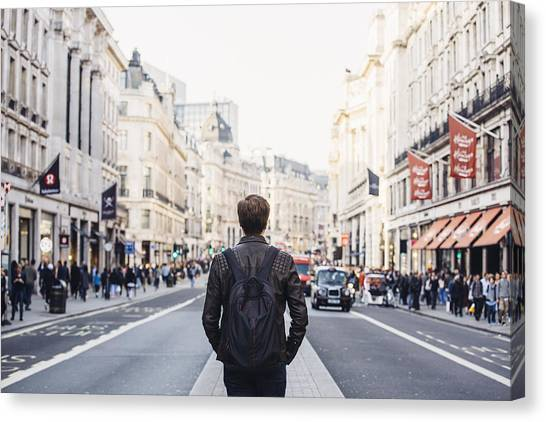 Tourist With Backpack Walking On Regent Street In London, Uk Canvas Print by Alexander Spatari