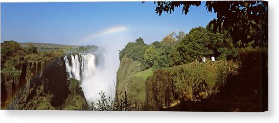Victoria Falls Canvas Print - Tourists At A Viewing Point Looking by Panoramic Images