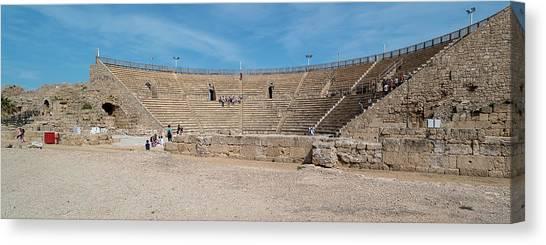 The Amphitheatre Canvas Print - Tourists At Amphitheatre, Caesarea, Tel by Panoramic Images