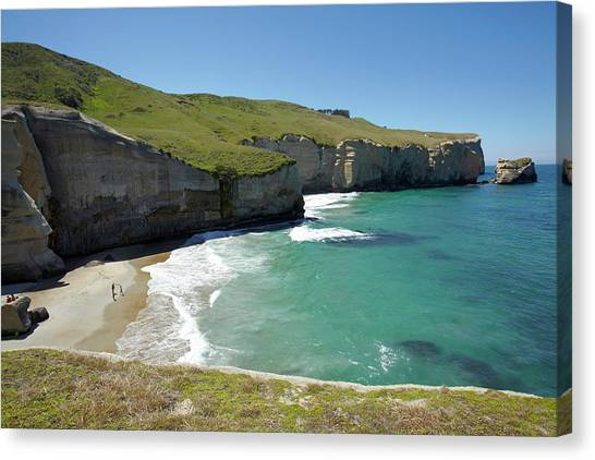 Beach Cliffs Canvas Print - Tourists On Beach And Cliffs At Tunnel by David Wall