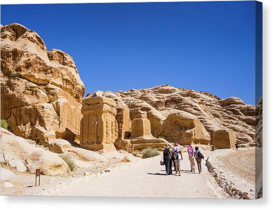 Arabian Desert Canvas Print - Tourists Walking On Footpath In Petra by Leslie Parrott