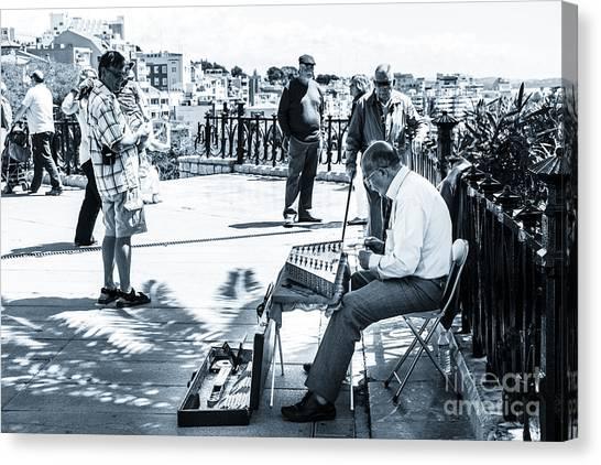 tourists watching busker playing santoor dulcimer at Tarragona S Canvas Print