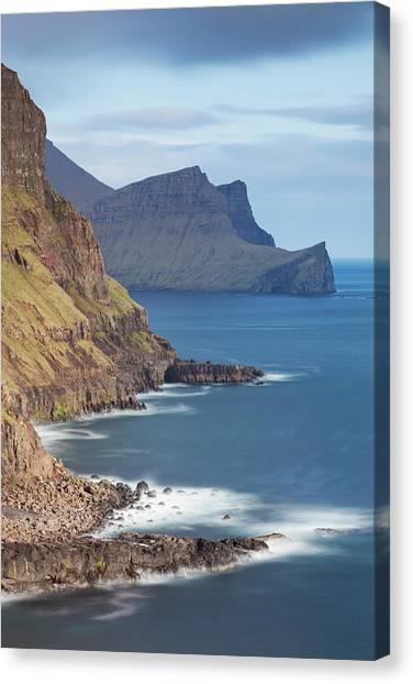 Cliff Burton Canvas Print - Towering Cliffs Near Gasadalur On The by Adam Burton / Robertharding