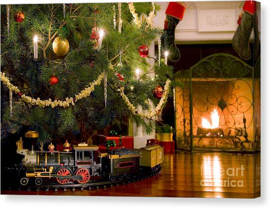 Toy Train Under The Christmas Tree Canvas Print