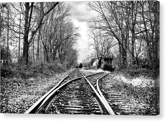 Tracks Of History Canvas Print by John Rizzuto