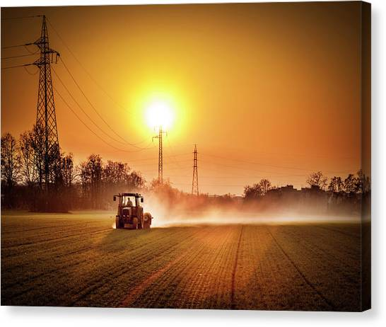 Tractor In A Field At Sunset Canvas Print by Rinocdz