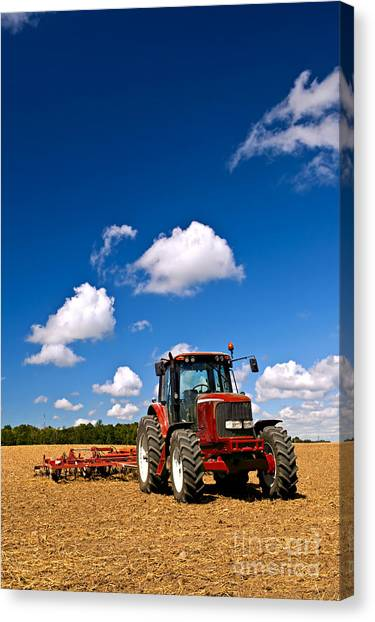 Tractors Canvas Print - Tractor In Plowed Field by Elena Elisseeva