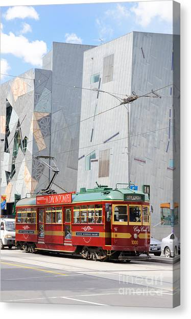 Traditional And Modern Symbols Of Melbourne - Tram And Architecture Canvas Print