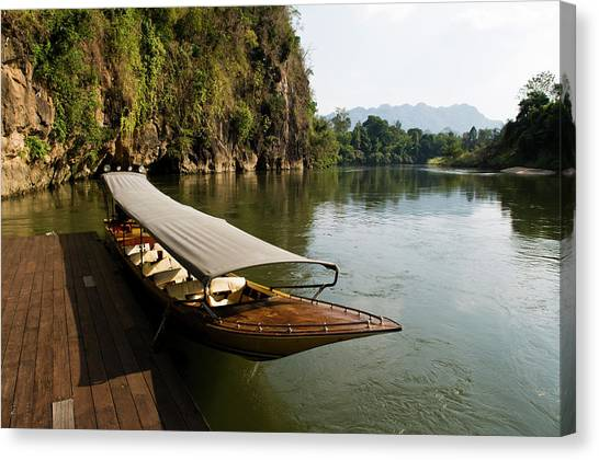 Yaks Canvas Print - Traditional Thai Long Boat Docked by Thomas Pickard