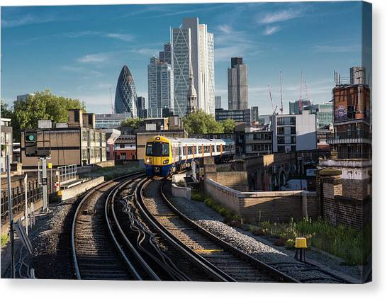 Train Leaving The City, London Uk Canvas Print by Tim E White