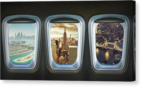 Traveling The World With An Airplane Canvas Print by Franckreporter