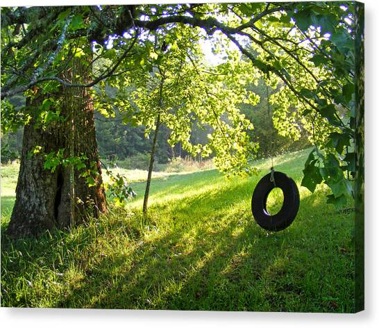 Tree And Tire Swing In Summer Canvas Print