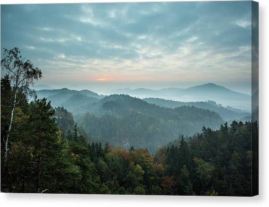 Trees And Mountain Range Against Cloudy Canvas Print by Wavebreakmedia Ltd