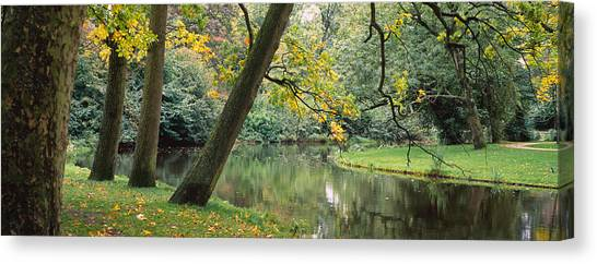 Fallen Leaf Canvas Print - Trees Near A Pond In A Park by Panoramic Images