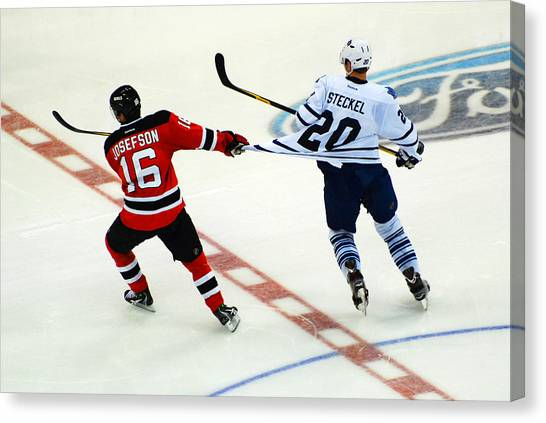 New Jersey Devils Canvas Print - Tugging On The Jersey by James Kirkikis